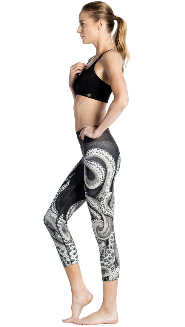 Left side view of black and white tentacle themed printed capri leggings