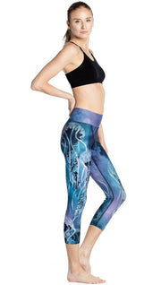 right side view of model wearing jellyfish themed printed capri leggings