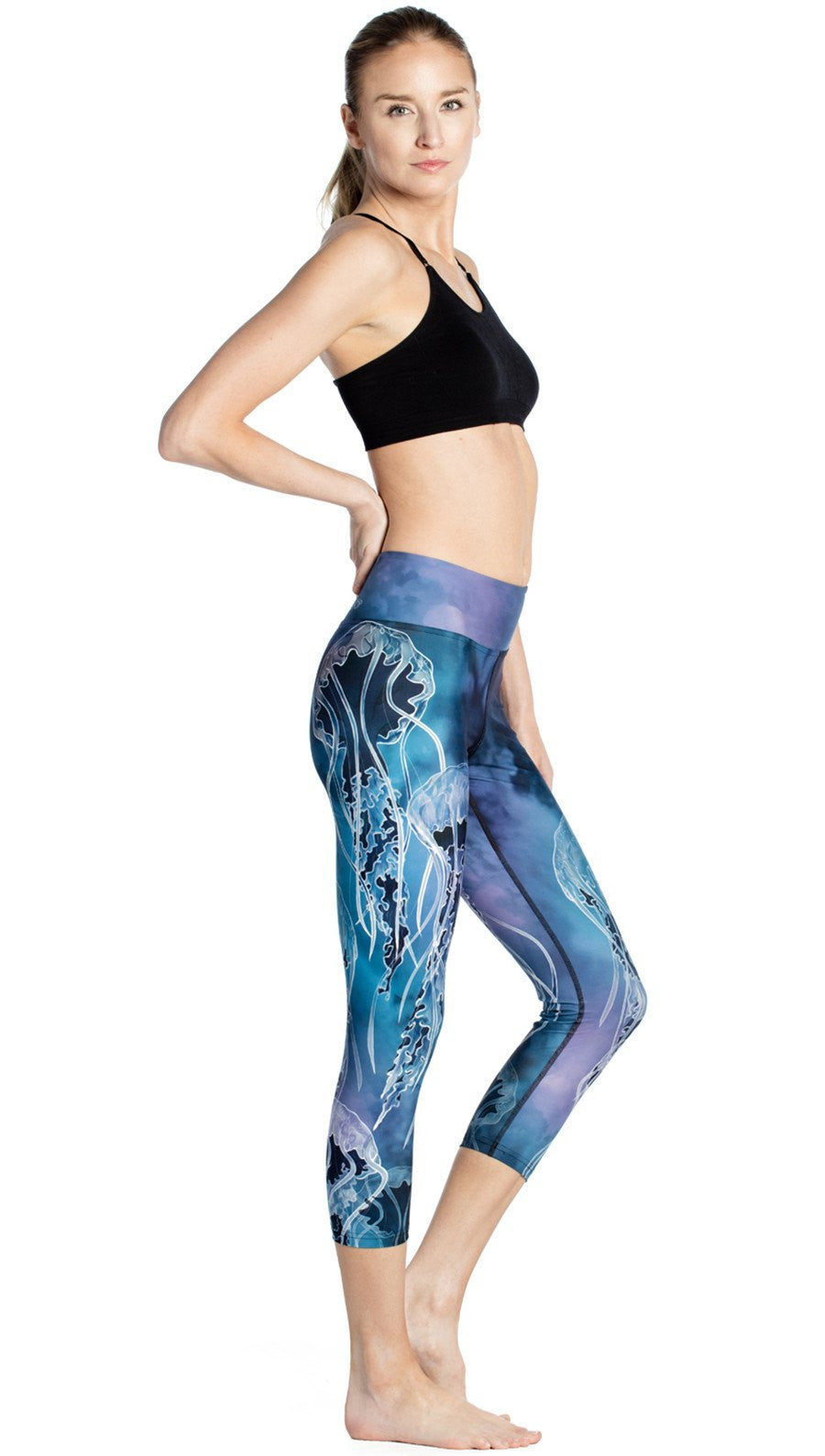 close up side view of jellyfish themed printed capri leggings