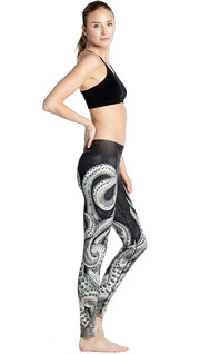 right side view of model wearing black and white tentacle themed printed full length leggings