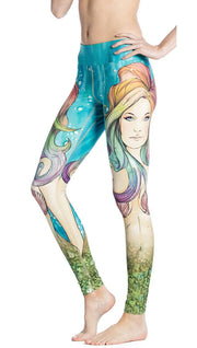close up left side view of model wearing colorful mermaid face themed printed full length leggings