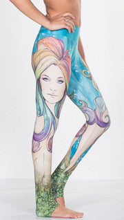 close up right side view of model wearing colorful mermaid face themed printed full length leggings