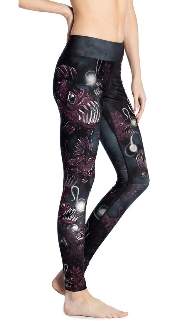 close up side view of deep sea angler fish printed full length leggings