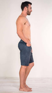 Right side view of model wearing slate men's performance shorts