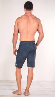 Back view of model wearing slate men's performance shorts