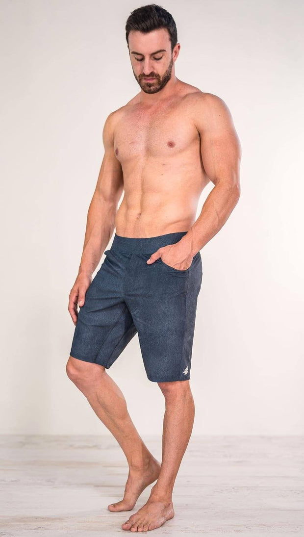 Diagonally left side view of model wearing slate mens performance shorts