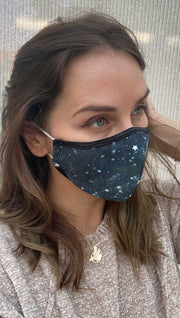 Right side view of model wearing a blue mask with tiny white stars