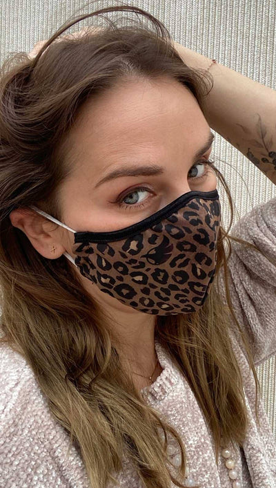 girl wearing leopard printed face mask