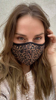 girl wearing leopard printed face mask.