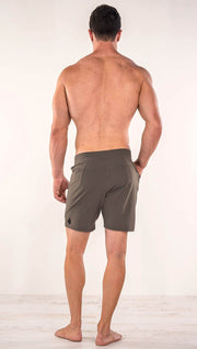 Back side view of model wearing men's taupe performance shorts with slim fit