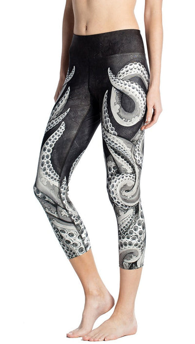 close up side view of black and white tentacle themed printed capri leggings