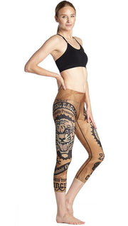 right side view of model wearing vintage circus tiger printed capri leggings
