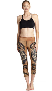 front view of model wearing vintage circus tiger printed capri leggings