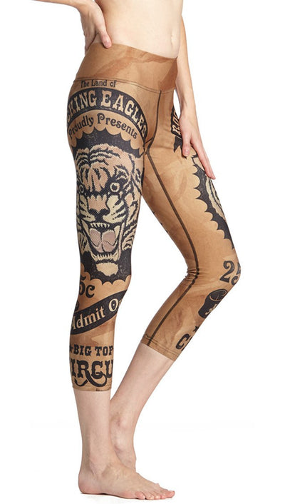 close up side view of vintage tiger ticket themed printed capri leggings