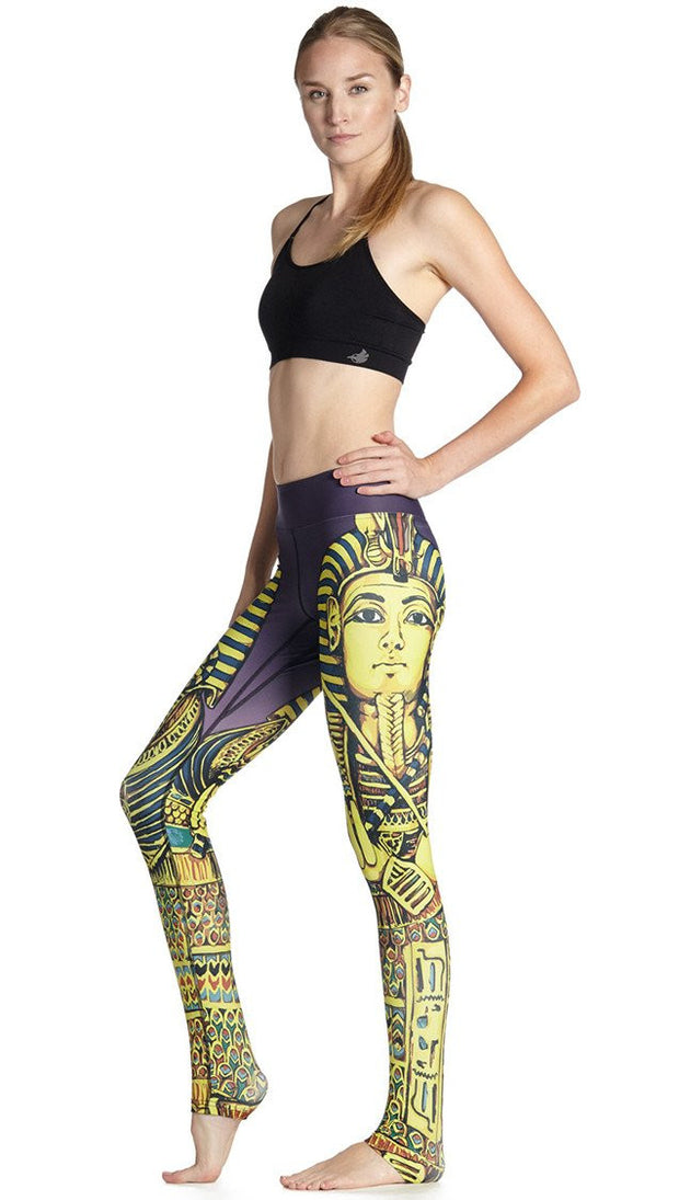 left side view of model wearing king tut themed printed full length leggings