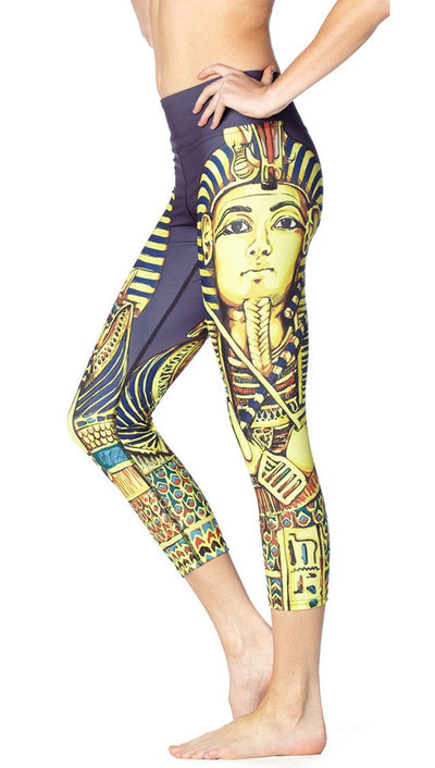 close up side view of King Tut themed printed capri leggings