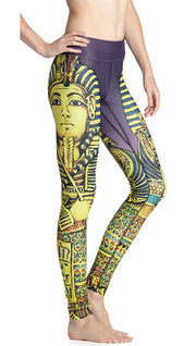 close up side view of model wearing king tut themed printed full length leggings