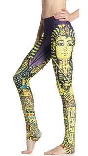close up left side view of model wearing king tut themed printed full length leggings