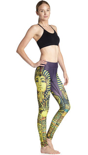 right side view of model wearing king tut themed printed full length leggings