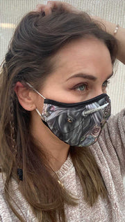 Right side view of model wearing a mask with a black unicorn and with roses printed
