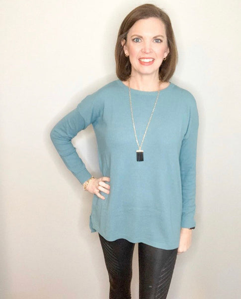 Blue Long Sleeve Top with Buttons Down the Back