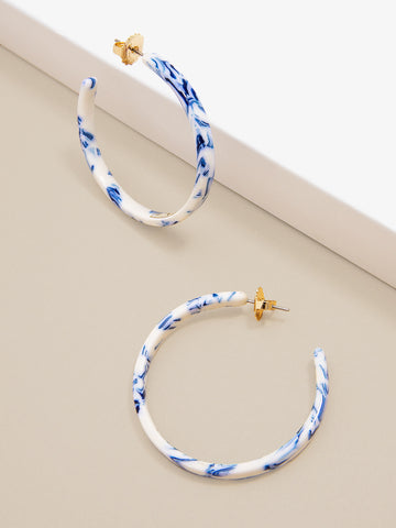 Blue and white marbled print hoops