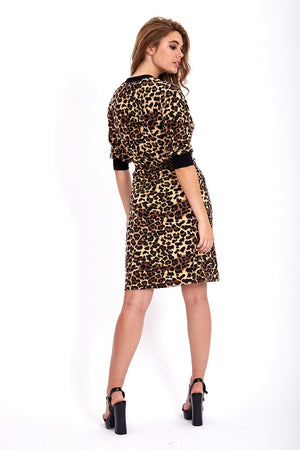 Divine Grace Jersey Mini Dress In Animal Print With Twisted Waist And Pockets