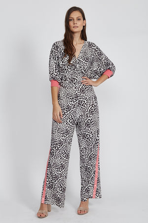 Liquorish Jumpsuit in Animal Print with Twisted Front and Pink Tape