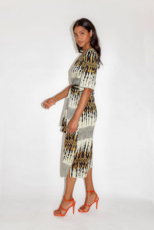 Divine Grace Midi Dress In Layered Animal Print With Twisted Front