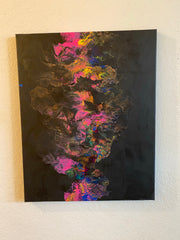 Pour painting of bright colors on black .Waves of pink, yellow, blue, gold and purple create a brilliant piece of art that would go lovely in your home.