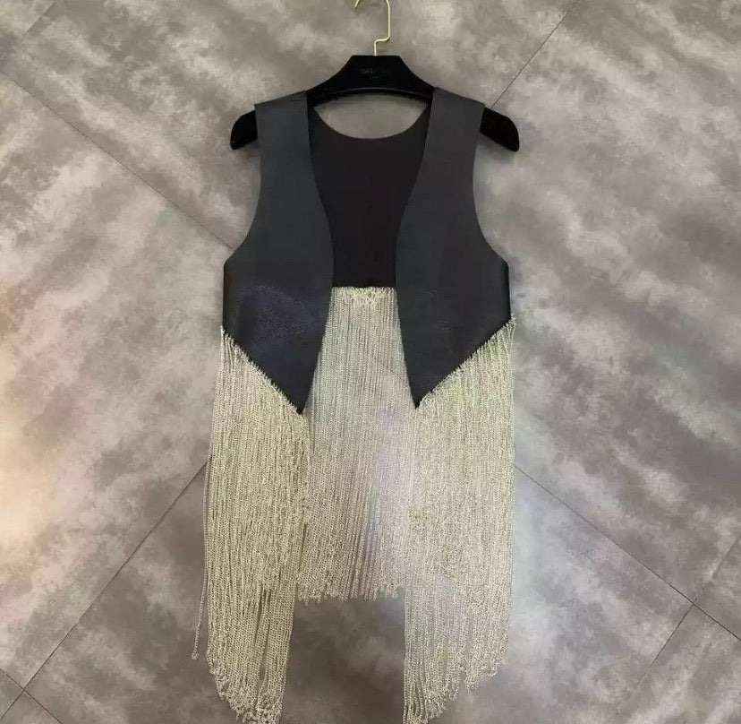 She's a leather Tassel Vest