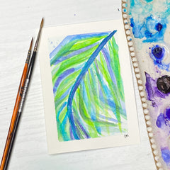 watercolor postcard of purple and green palm leaf