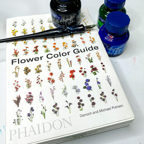 image of phaidon flower color guide and winsor newton calligraphy pen and ink