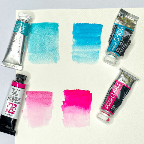 watercolor and gouache paint tubes with swatches of cobalt blue and pink