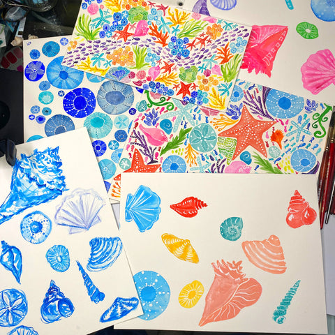 paintings with various multicolored watercolor seashells