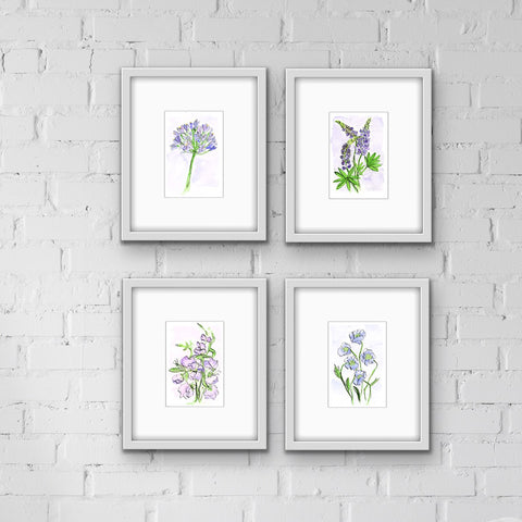 Framed watercolor floral prints in a group of 4 all in shades of purple
