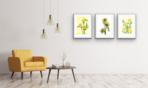 3 framed yellow floral watercolor prints in a a living room with a yellow arm chair and table