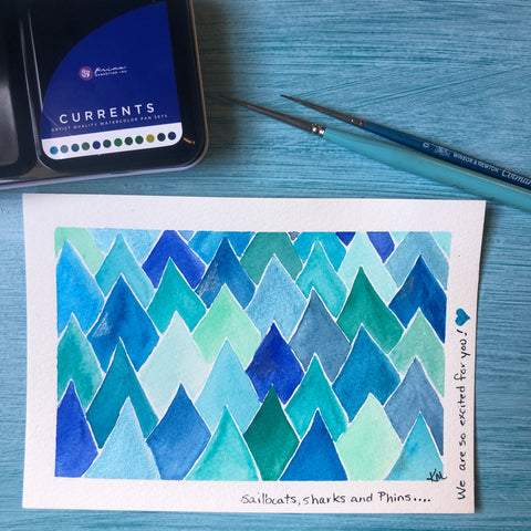 watercolor painted postcard, watercolor paint and paint brush.  Card has a pattern of blue diamonds