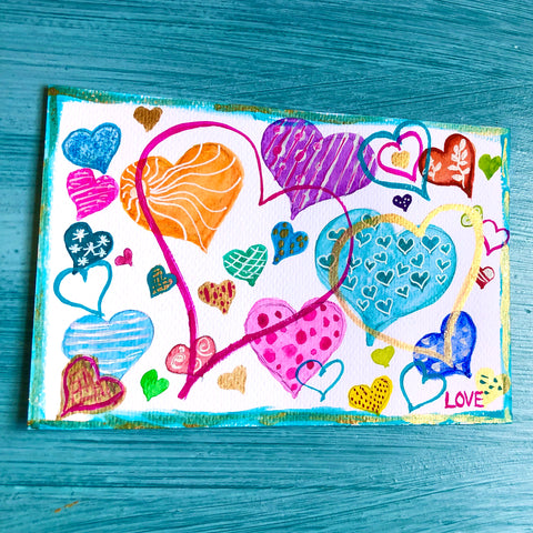 a watercolor postcard with many hearts of different size shapes and colors