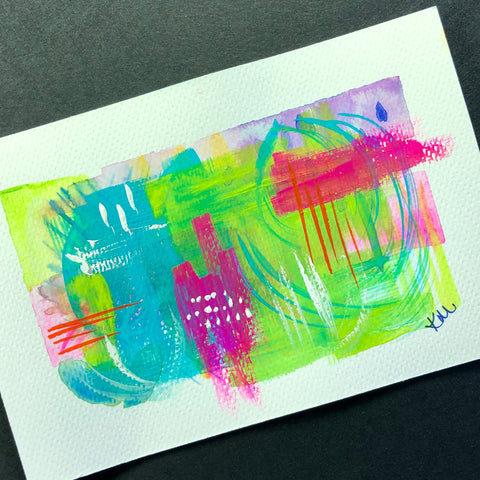 watercolor postcard with bright pink and blue and green abstract painting