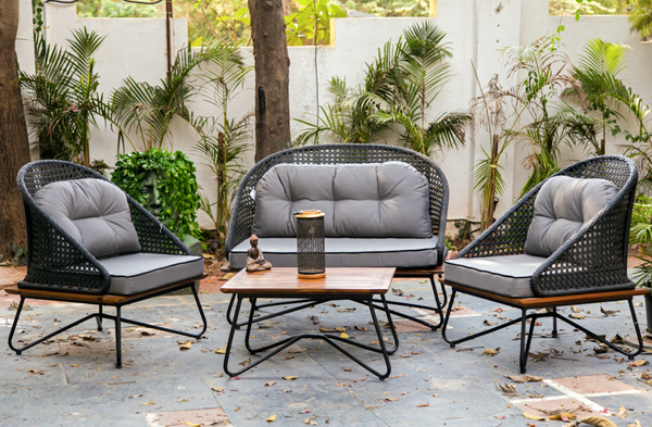 Outdoor Sofa set with center table made of black ribbed wicker, rose wood and iron stand