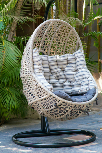 outdoor swing on iron stand made of grey marble wicker
