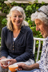 carer looking at husband with parkinsons