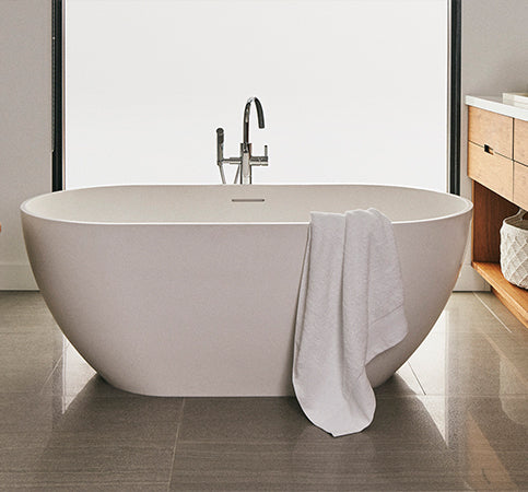 Towel Collection main, bathroom with towel set on stand, bath tub with bath towel, sink with towels sets underneath