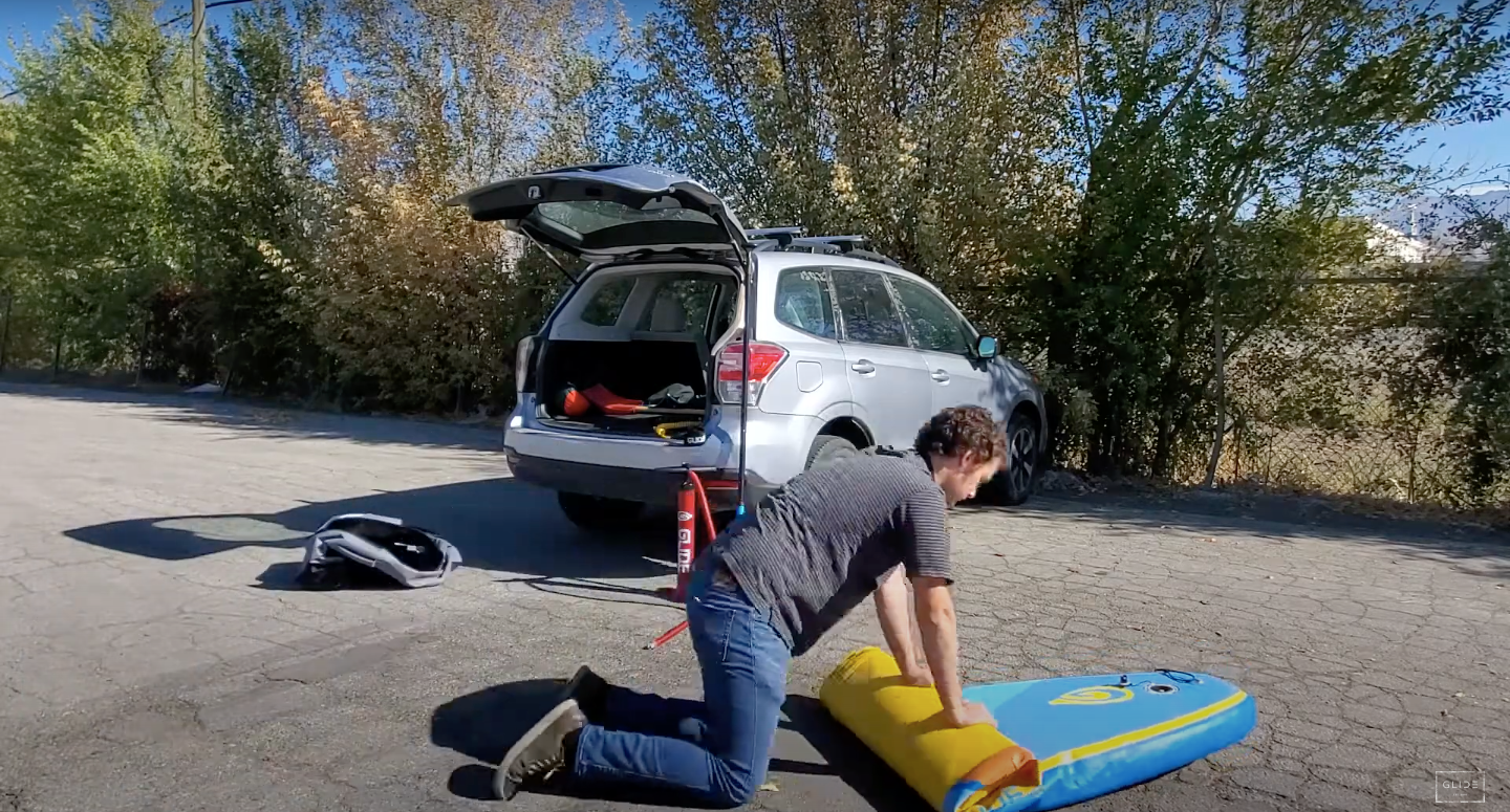 how to roll up an inflatable paddle board