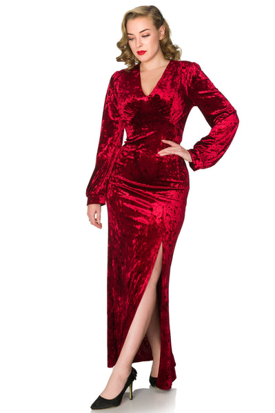 Timeless London Miley wine red luxury crushed velvet maxi dress, with side split low V-neck and long sleeves. Made sustainably.