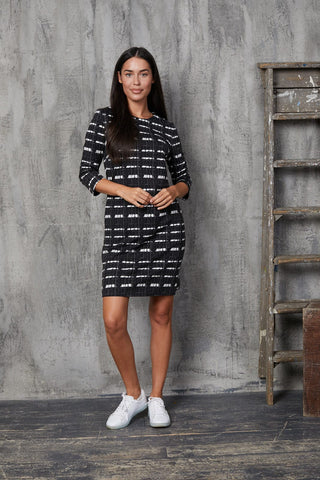 Timeless London contemporary Heidi shift dress with black and white check pattern. With regular fit, round neck and 3 quarter length sleeves. Made sustainably.