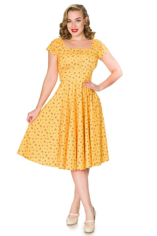Timeless London Aaliyah Dress yellow base dress with pink floral print and fit and flare fit.