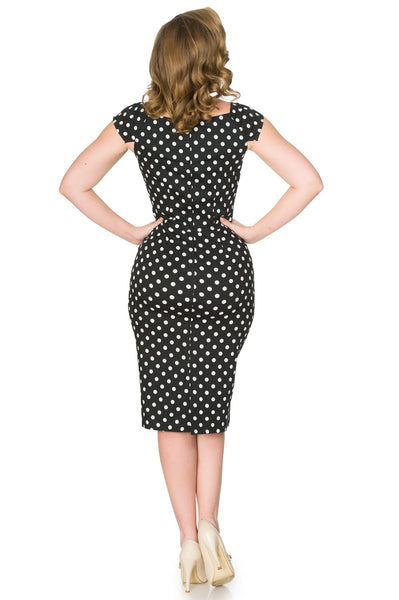 Timeless London Arielle Black and White Polka Dot pencil Dress with boat neckline, cap sleeves and pockets. Made sustainably.