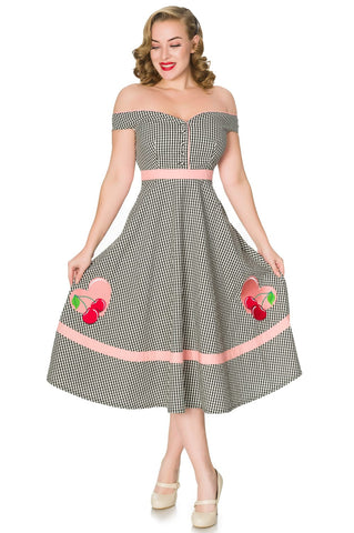 Timeless London Heartbreaker black and white gingham off-shoulder swing dress. Features pink heart & cherry pattern, pink stripe detail on fitted waist and flared midi swing skirt. Off shoulder sweetheart neckline features matching gingham buttons. Made sustainably.